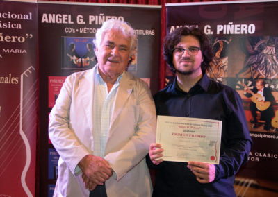 Angel G. Piñero with the winner of the contest, Luca Romanelli